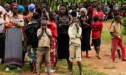 Mourning: The scene in Oicha, in the Beni region, on November 29 after more than two dozen people were hacked to death.  By Bienvenu-Marie BAKUMANYA (AFP/File)