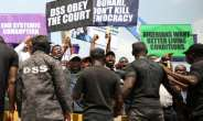 People demonstrate to demand the release of opposition activist Omoyele Sowore in November 2019 in Abuja.  By Kola Sulaimon (AFP/File)