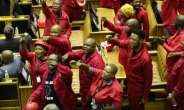 President Cyril Ramaphosa was forced to delay his annual State of the Union address after MPs of the far-left Economic Freedom Fighters staged a rowdy protest, demanding De Klerk be ejected from parliament.  By SUMAYA HISHAM (POOL/AFP/File)