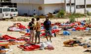 The International Organization for Migration says aound 300 migrants are still being held in a Libyan detention centre just days after aan air  strike there killed 44 migrants.  By Mahmud TURKIA (AFP)