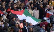 Tunisian demonstrators carry a Palestinian flag during a protest against US President Donald Trump's Middle East peace plan on February 5, 2020.  By FETHI BELAID (AFP/File)