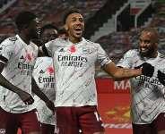 Partey celebrates with Arsenal teammates