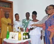 2020 retirees cutting a cake to celebrate the occasion. With them are from left, Mr Steve Poku-Kwateng and Mrs Angela Awere-Kyere (extreme right). Next to Poku-Kwateng are Ms. Mary Esi Misenu, Christopher Aguyiba, Ms. Judith Anku and Mr. Paul Date.