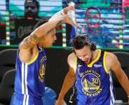 Stephen Curry was soaked by fellow Warriors player Juan Toscano-Anderson after the win