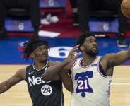 Joel Embiid (right) has played for the Philadelphia 76ers since 2014