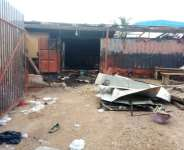 Angry Mankessim youth destroy new market foundation, fence