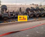 Falling truck loaded with cement kills Driver's Mate