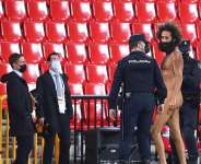 A streaker is being apprehended by the police © Getty Images