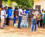 Mr. Akum-Nyemi donating the medical items to the health centres Directors on behalf of ToH