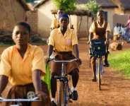 Schoolgirls on bicycles in Ghana, photo credit: UNICEF