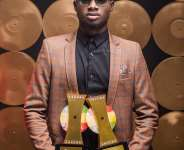 Kuami Eugene aka Rockstar showcases his awards after the 2020 VGMA