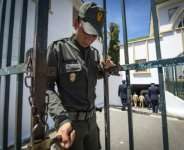 A member of Morocco's security forces locks the entrance to a court in Sale near the capital Rabat in this file picture taken on May 16, 2019.  By FADEL SENNA (AFP/File)