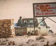 A vehicle of the royal Moroccan armed forces is seen on the Moroccan side of a border crossing point between Morocco and Mauritania in Guerguerat in the far south of Western Sahara, on November 25.  By Fadel SENNA (AFP/File)