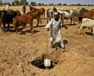 After years of conflict in Sudan's Darfur, the region is awash with automatic weapons and clashes still erupt, often over land and access to water.  By ASHRAF SHAZLY (AFP)