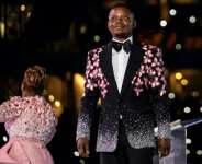 Arrested: Shepherd Bushiri, seen here on stage with his wife, Mary Bushiri, at a stadium in Soweto on New Year's Day.  By WIKUS DE WET (AFP)
