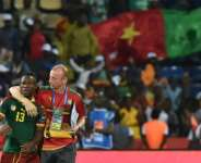 Assistant coach Sven Vandenbroeck (R) celebrates with midfielder Christian Bassogog after Cameroon won the 2017 Africa Cup of Nations in Libreville..  By ISSOUF SANOGO (AFP)