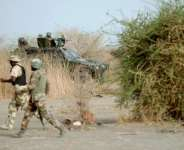 Soldiers on patrol close to a former Boko Haram camp near Maiduguri, northeast Nigeria on June 5, 2013.  By Quentin Leboucher (AFP/File)