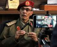 Colonel Ali Madi, head of the military prosecution in eastern Libya's Benghazi, gives a press conference in the city on March 27, 2021.  By Abdullah DOMA (AFP)