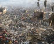 Devastation: Stunned inhabitants of Susan's Bay looked at the aftermath of the fire.  By Saidu BAH (AFP)