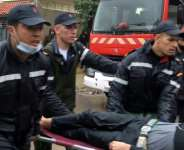 Emergency services carry a man on a stretcher outside the workshop  in  Tangiers.  By - (AFP)