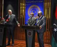 Greek Foreign Minister Nikos Dendias and Libya's deputy premier, Hussein Attiya al-Gotrani (R), hold a news conference in the eastern city of Benghazi.  By Abdullah DOMA (AFP)