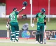 In the runs: Pakistan's Fakhar Zaman celebrates after scoring his second successive century in the third ODI against South Africa.  By PHILL MAGAKOE (AFP/File)