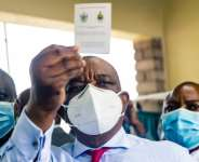 I've been jabbed: Vice President Constantino Chiwenga, who is also health minister, holds up his vaccination certificate.  By Jekesai NJIKIZANA (AFP)