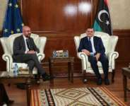 Libya's interim Prime Minister Abdul Hamid Dbeibah (R) meets with European Council President Charles Michel on Sunday.  By - (AFP)