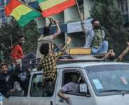 People in the Ethiopian capital Addis Ababa celebrate the successful filling of the Grand Ethiopian Renaissance Dam (GERD) as the dam's first two turbines' electricity production is tested in August 2020.  By Amanuel SILESHI (AFP/File)