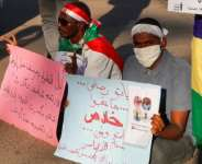 Relatives of protesters slain in demonstrations against the former regime hold a rally for justice in Khartoum in January 2021.  By ASHRAF SHAZLY (AFP/File)