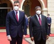 Spanish PM Sanchez, left, with Angolan President Joao Lourenco. Spain is seeking to bolster its tourism-driven economy hard hit by the coronavirus pandemic.  By Osvaldo Silva (AFP)