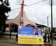 Talon, seen here in one of his campaign posters, is widely expected to win Sunday's election.  By PIUS UTOMI EKPEI (AFP)