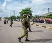 Tanzanian police officers last week patrol outside Garagara Playground polling station in Mtoni, Zanzibar..  By Patrick Meinhardt (AFP)