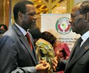 The African Union's former envoy on Mali, Pierre Buyoya, pictured left at a West African summit in Ivory Coast in March 2014. To the right is Ivorian President Alassane Ouattara.  By ISSOUF SANOGO (AFP)