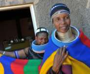 Traditional Ndebele dress includes multicoloured shawls worn around the shoulders for both men and women.  By ALEXANDER JOE (AFP/File)