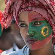 Follower: A woman's face is painted with the flag of the Oromo Liberation Front at celebrations in September 2018 to mark the return of the once-banned OLF to Addis Ababa.  By MIchael TEWELDE (AFP)