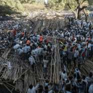 Hundreds had been sitting on a tiered wooden structure for hours when it collapsed.  By EDUARDO SOTERAS (AFP)