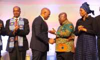 President Akufo-Addo in a handshake with Tony Elemulu (2nd L, Chairman, Tony Elemulu Foundation) while other dignitaries look on