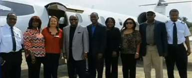 *Final picture: Dr Myles Munroe, left of center in a gray jacket, poses with his wife, second left, and members of their congregation. The picture was taken two years