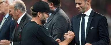 UEFA president Aleksander Ceferin (right) with Liverpool boss Jurgen Klopp (left)