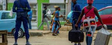 Despite the restrictions, many Angolans view earning money, finding food and fetching water as legitimate reasons to leave home.  By Osvaldo Silva (AFP)