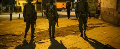 On patrol: Nairobi police during the curfew.  By Yasuyoshi CHIBA (AFP)