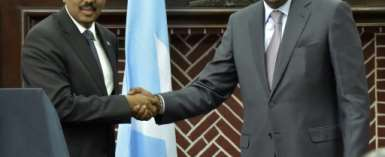 The agreement followed a meeting between President Uhuru Kenyatta (R) and his Somali counterpart, Mohamed Abdullahi Mohamed (L).  By SIMON MAINA (AFP/File)