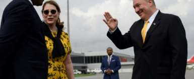 US Secretary of State, Mike Pompeo (R), and his wife, Susan Pompeo (C), travelled to Angola.  By ANDREW CABALLERO-REYNOLDS (POOL/AFP)