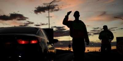 Military police check the travel permits of travelers at a roadblock in Gaborone, Botswana on April 5, 2020. Police in Botswana charged staff members at Moeladilotlhoko News Boiler with criminal trespass. (AFP/Monirul Bhuiyan)