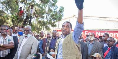 Hakainde Hichilema, leader of the United Party for National Development (UPND), addresses supporters in the Zambian capital Lusaka on December 23, 2020. UPND supporters attacked reporter for state-owned Zambia News and Information Services Victor Mwila. (AFP/Salim Dawood)