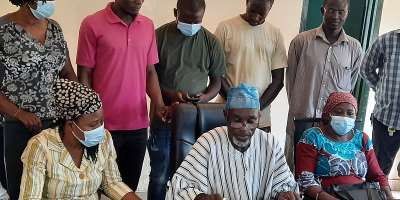 Mr Dassah (flanked by some poultry farmers and egg sellers) reading the press statement