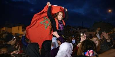 A girl waves the Moroccan flag during protests on February 19 against the closure of the border with the Spanish enclave of Ceuta.  By FADEL SENNA (AFP)