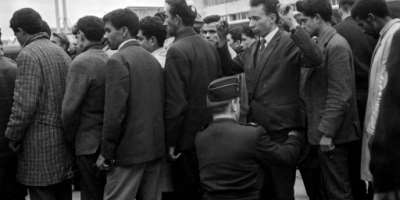 Algerians arrested during the demonstration in Paris on October 17, 1961  are searched before boarding a plane bound for Algeria.  By - (AFP)