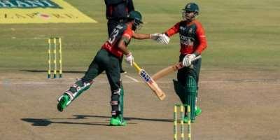 Bangladesh opening batsmen Mohammad Naim (L) and Soumya Sarkar (R) fist bump during a 102-run first-wicket stand in a Twenty20 international against Zimbabwe in Harare on Thursday.  By Jekesai NJIKIZANA (AFP)
